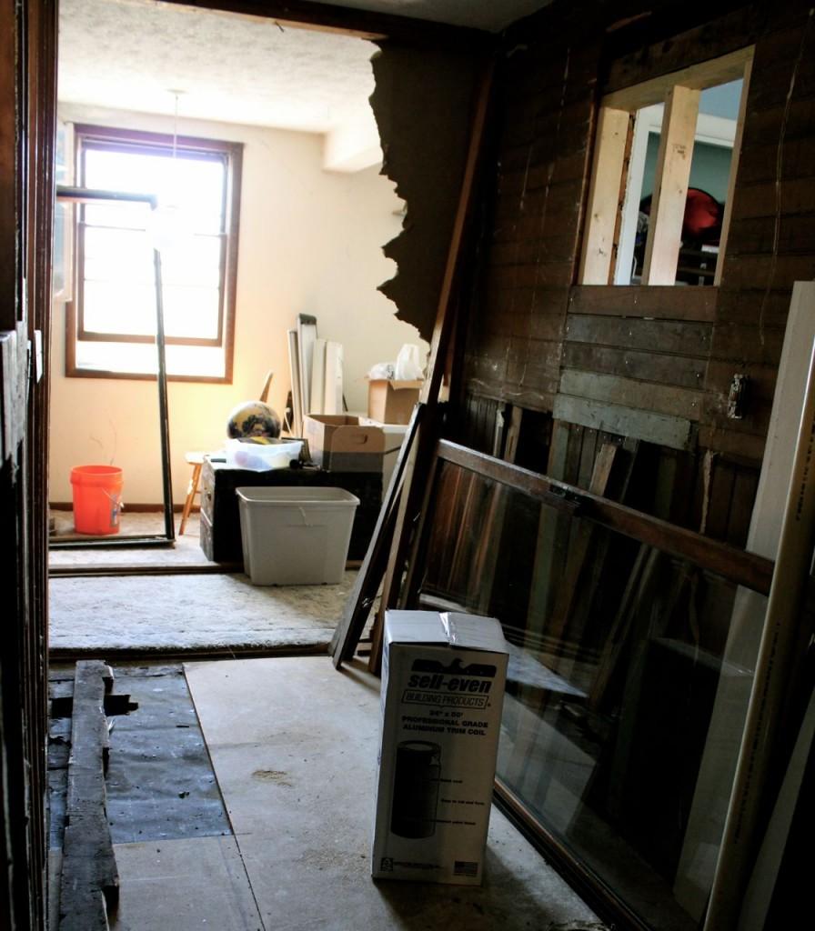 Beginning days of gutting the soon-to-be walk-through pantry.