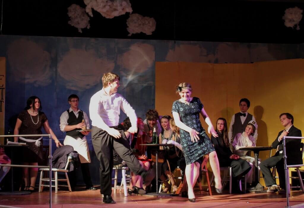 Pair dancing the Charleston onstage.