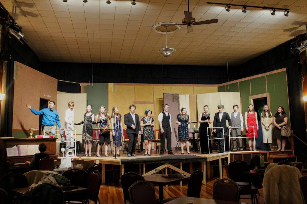 theatre cast onstage singing