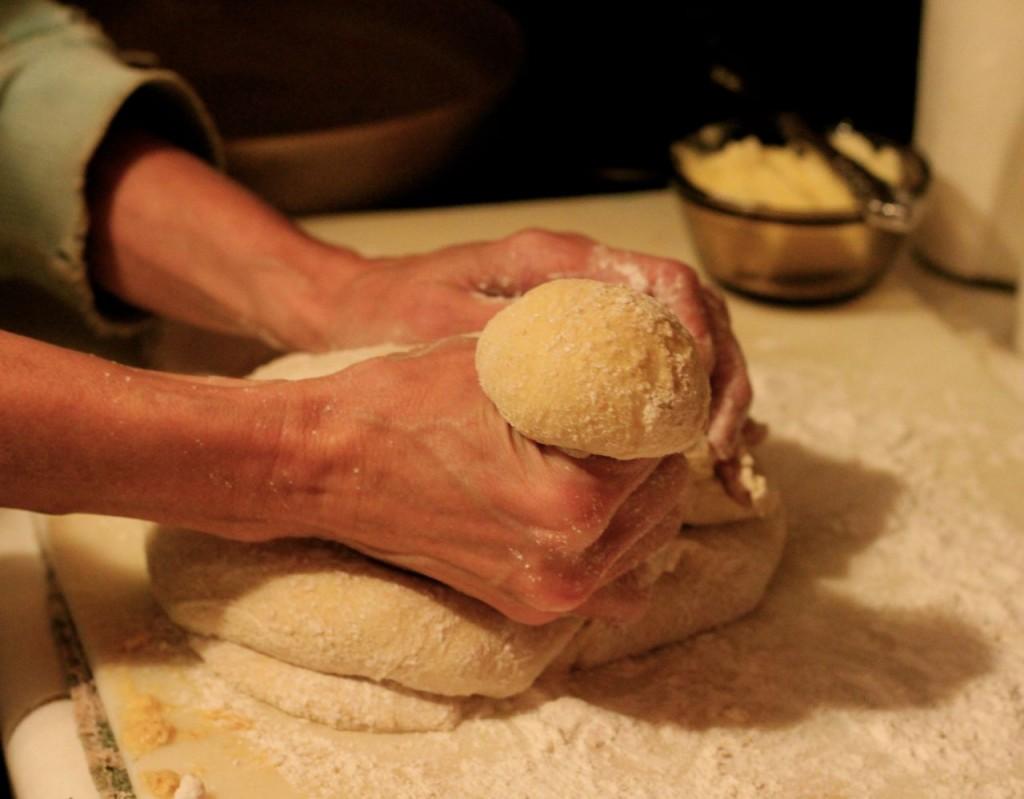 Pinch off a ball of dough a little bigger than a golf ball .  .