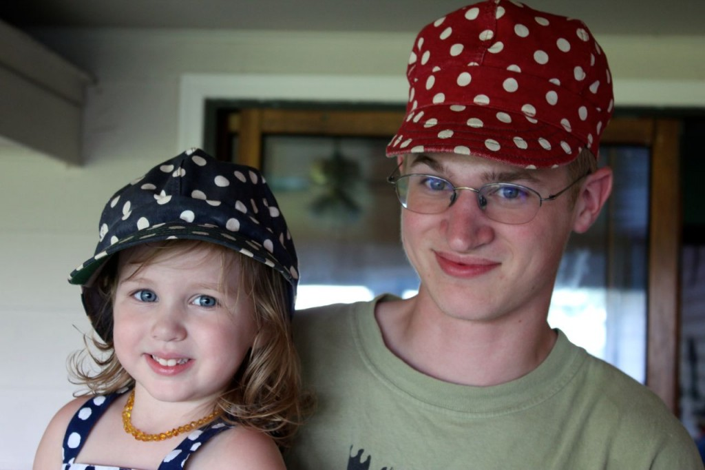 two cuties and their polska-bot hats