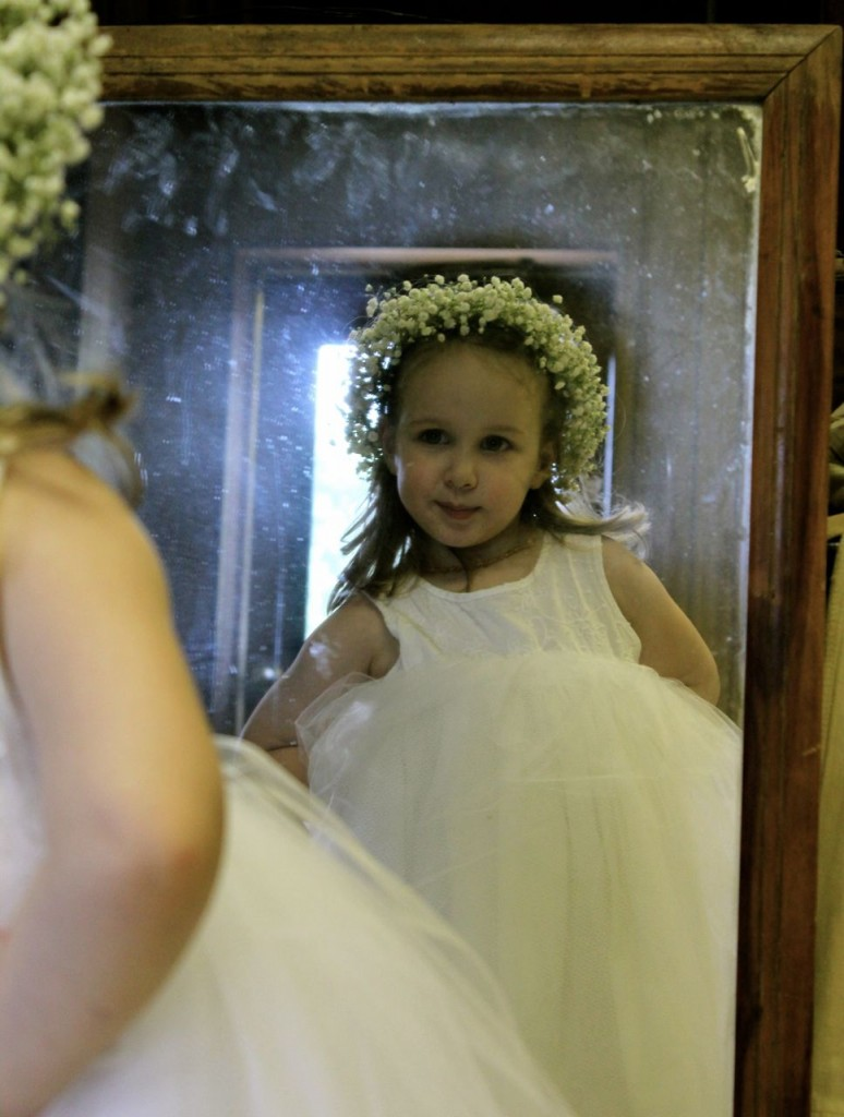 Our granddaughter Anya was one of the flower girls. Here she is, admiring her wedding look in the mirror. (Photo by Amalia Miller.)