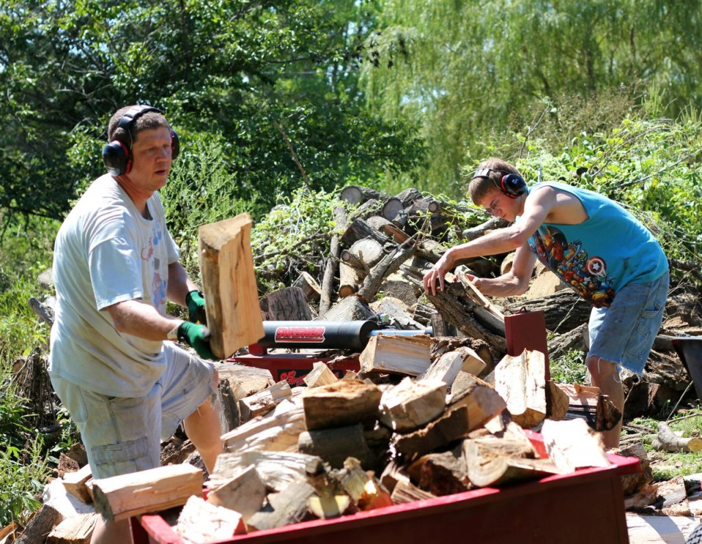 Here Timothy and Bryan work up a few of the sailor logs.